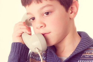 cute child with vintage telephone