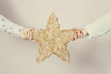 christmas star on couple hands