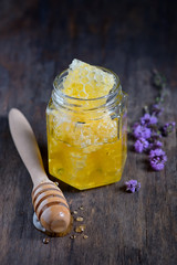 jar of honey with honeycomb