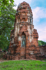 Standing Buddha statue inside ruined pagoda at Ayuttha Historica