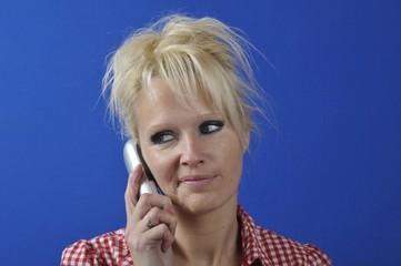 Blond woman phoning