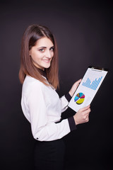 Portrait of business woman with clipboard