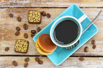 "Cup of coffee with Japanese cookie ""kuri dora"" and chocolates"