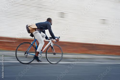 Leinwandbild Motiv riding bike black man