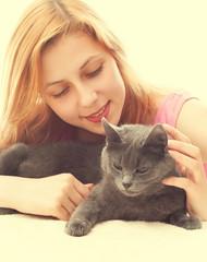 beautiful girl and gray cat