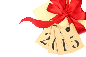 Gift box with red bow and tags with new year 2015