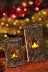 electric candles with christmas decorations in atmospheric light