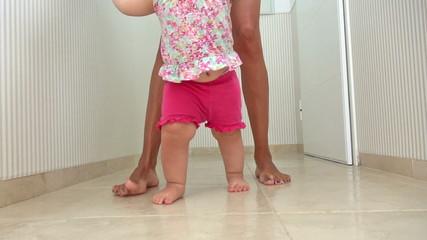mom and baby walking indoor