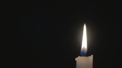 One bright burning candle. HD.
