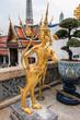 Golden Kinnari statue at temple,Wat Phra Kaew in Grand Palace, B