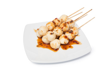 Grilled chicken meat ball with sweet spicy sauce isolated on whi