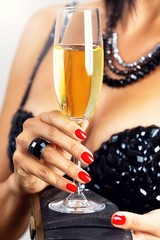 Close up of a elegant woman holding glass of champagne.