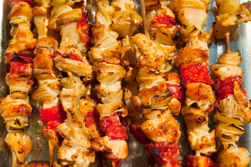 Roast chicken meat sticks on barbecue