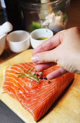 Beautiful filet of salmon on the wooden background