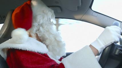 Santa Driving - Santa Claus on a bumpy forest road.