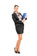 Businesswoman holding a folder with documents