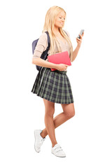 Schoolgirl looking at a cell phone