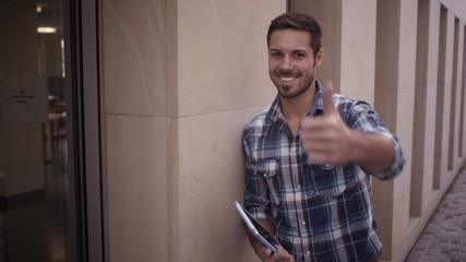 Man Showing Thumbs Up Toward Camera