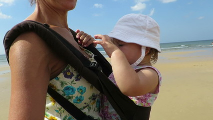 mother carrying baby in rucksack