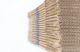 Stacked brown corrugated cardboard boxes isolated on white