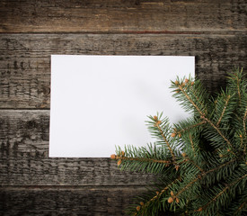 Card with  Christmas tree on wooden background
