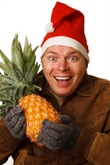 Man in Santa hat with pineapple.