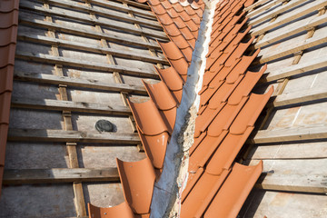 Valley gutter and red tiles construction