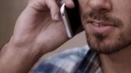 Close up of young man enjoying conversation on phone