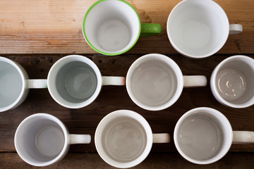 Group of different mugs on wooden table