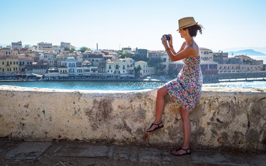 Woman photographing during holidays in Europe
