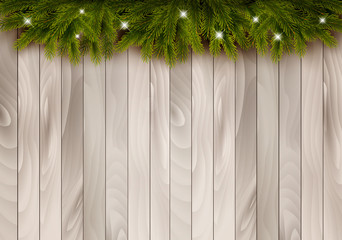 Christmas wooden background with branches and baubles. Vector.
