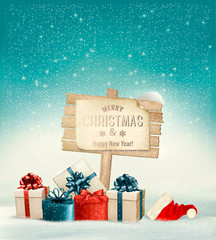 Winter christmas with a sign, gift boxes and a santa hat backgro