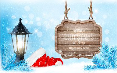 Winter christmas with a sign, lantern and a santa hat background