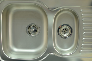 Stainless steel sink with drain. Closeup.