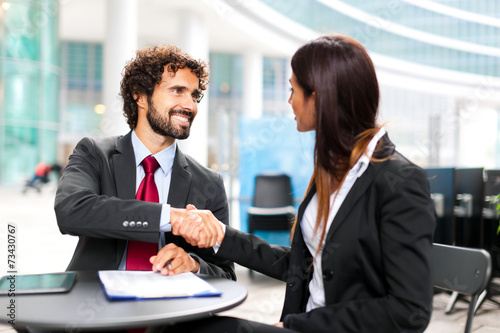Business people signing a contract - 73430767