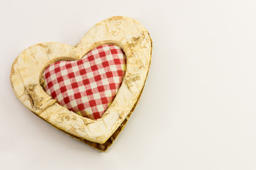 wooden heart, squared textile in the middle