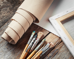 Artist canvas in roll, canvas stretcher and paintbrushes