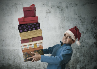 child with christmas gifts stacked