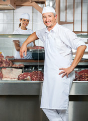 Confident Butchers With Female Colleague In Butchery