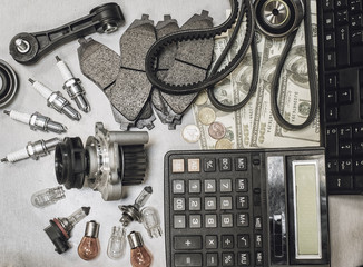 automotive parts for the repair money and calculator
