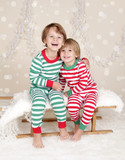 Winter Holidays: Laughing Happy Kids in Christmas Pajamas Sled i