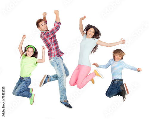 Young happy family jumping - 73432725