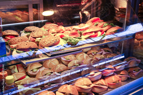 Fotobehang Buffet, Bar Collection of sandwiches in a shop window