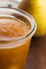 glass of pear jam with orange