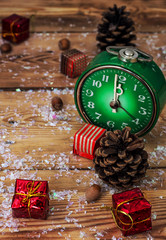green old-fashioned clock and Christmas ornaments