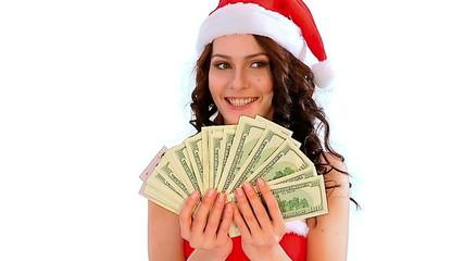 Woman in Santa hat holding money dollar