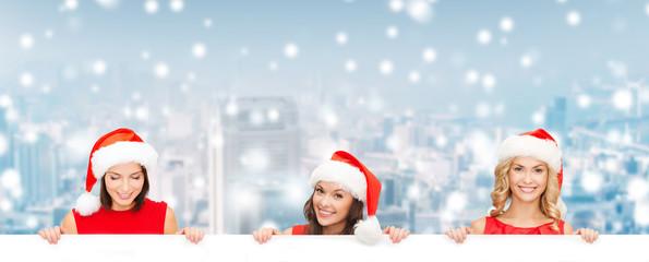 women in santa helper hat with blank white board