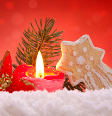 Christmas decoration and cookie with advent candle.