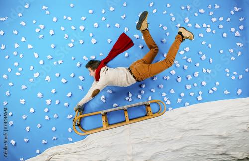 Fototapeta Young man on sled having fun