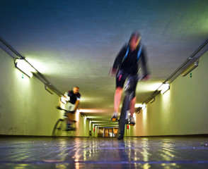 Two bikers in a tunnel